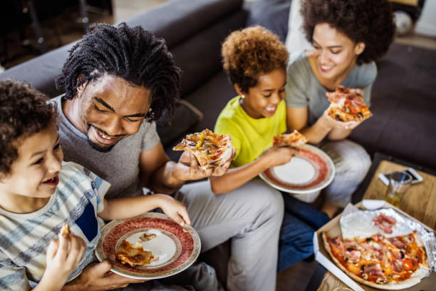 Happy african american family eating pizza at home picture id1135072251?b=1&k=6&m=1135072251&s=612x612&w=0&h=mqnz8ej2imzzeba8ged0coid5ncqdbp vslldne0jjw=