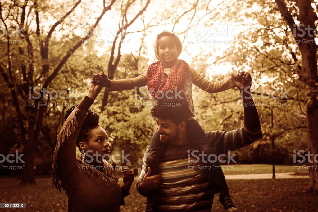 Happy African American family in park. royalty-free stock photo