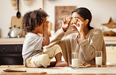 istock happy african american family: mother and little son eat cookies with milk at home 1282223474