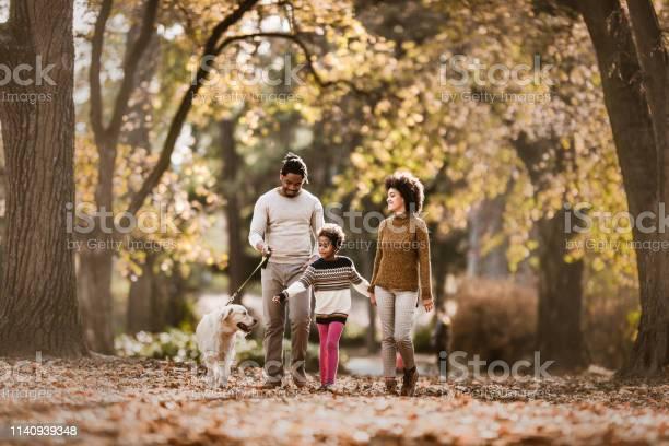 Happy african american family taking their dog for an autumn walk picture id1140939348?b=1&k=6&m=1140939348&s=612x612&h=hf99em0zkfaf41yv78ju6dszul4lbcfw4kcb3vm9ewk=