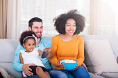 istock Happy African American Family watching TV and eating popcorn 540611152