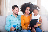 istock Happy African American family with technology at home. 540611270