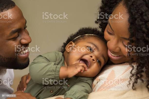 Happy african american family with their little girl picture id911983320?b=1&k=6&m=911983320&s=612x612&h=ts4uhxfjbdk61ejjhsrazg9b4q69svauu3wlch60jui=