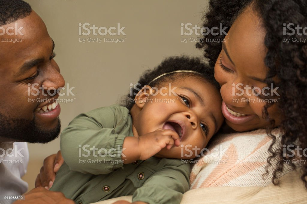 Happy African American family with their little girl. stock photo