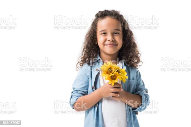 Happy african american girl holding yellow flowers and smiling at picture id833437062?b=1&k=6&m=833437062&s=612x612&h=7rmznhuxls3pcce6jixhoejoh7nn v 5z0amdesklbu=