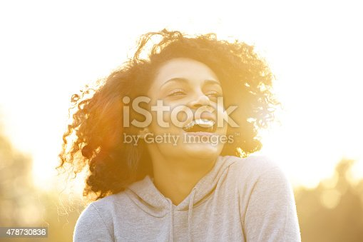 istock Happy african american girl laughing outdoors 478730836