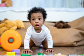 istock Happy African American Little baby boy crawling and looking for some thing to learn 1314801961