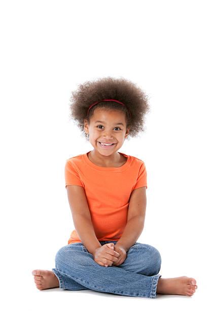 happy african american little girl sits in anticipation - 6 7 år bildbanksfoton och bilder