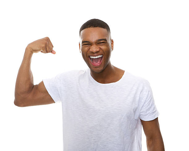Happy african american man flexing arm muscle Close up portrait of a happy african american man flexing arm muscle bicep stock pictures, royalty-free photos & images