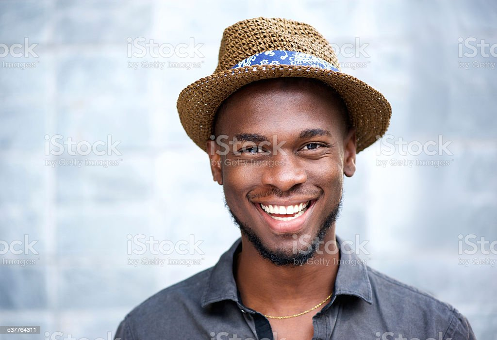 Happy african american man laughing stock photo