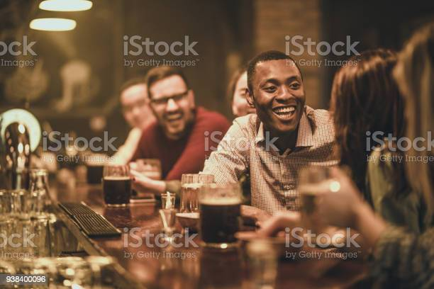 Happy african american man talking to his friend during the night out picture id938400096?b=1&k=6&m=938400096&s=612x612&h=slnla4vknldtqb4efhrlcqoypil0uho2uouvv5yl1a4=