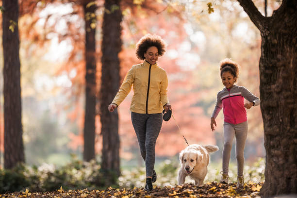 Happy african american mother and daughter running with golden in picture id1042942536?b=1&k=6&m=1042942536&s=612x612&w=0&h=5fsqcv etzdxf7romosmvktuwn ua11hrmq81evlsi4=