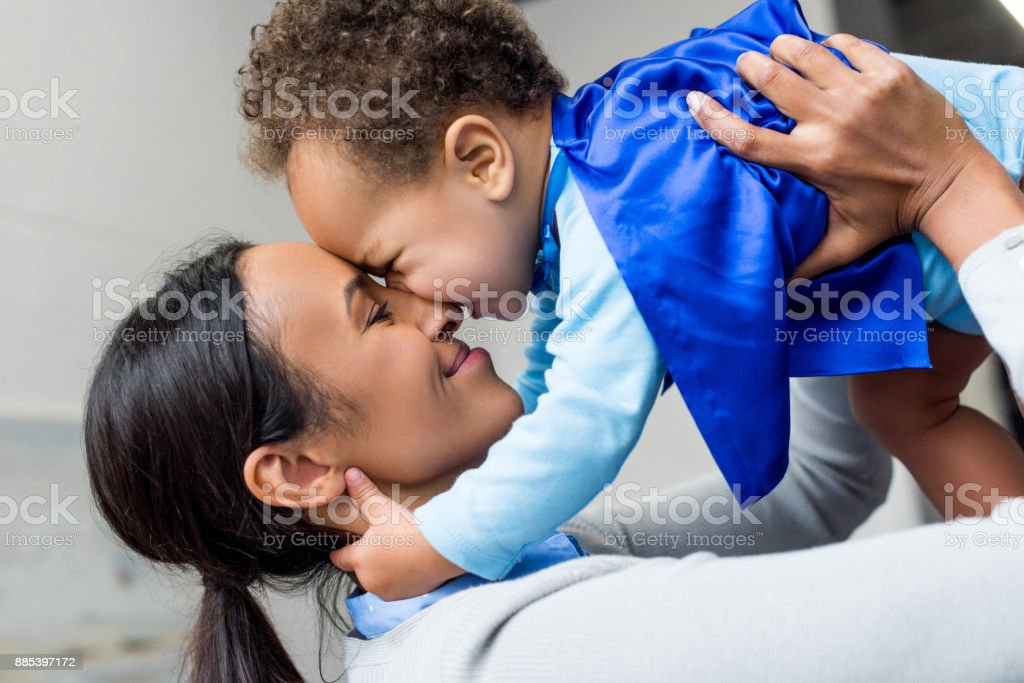 happy african american mother and son stock photo