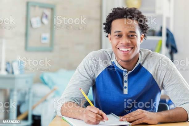 Happy african american student works on homework picture id666835392?b=1&k=6&m=666835392&s=612x612&h=pp ehzttxlkdtyvmbg62ztwr 9o0qqlnooqipfuijju=
