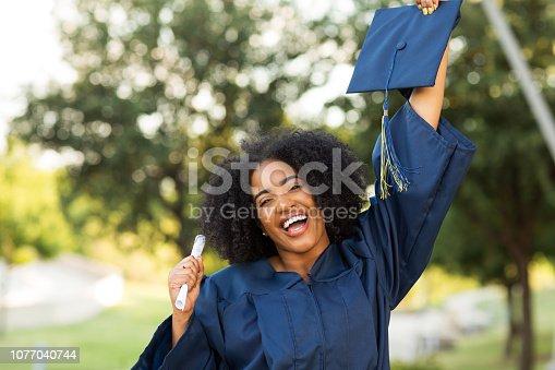 istock Happy African American woman at graduation. 1077040744