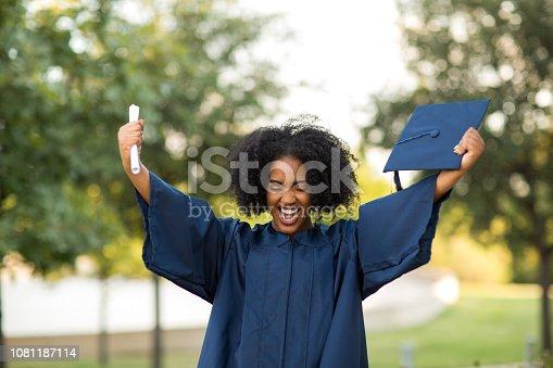 istock Happy African American woman at graduation. 1081187114