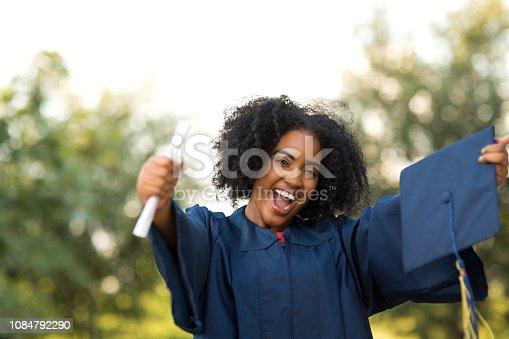 istock Happy African American woman at graduation. 1084792290