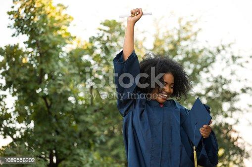 istock Happy African American woman at graduation. 1089556202