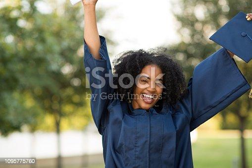 istock Happy African American woman at graduation. 1095775760