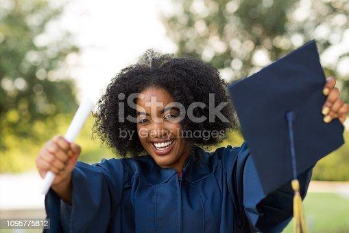 istock Happy African American woman at graduation. 1095775812
