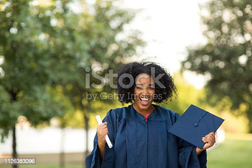 istock Happy African American woman at graduation. 1126383096