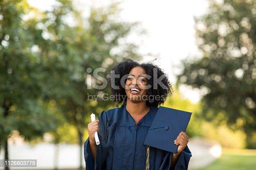 istock Happy African American woman at graduation. 1126603775