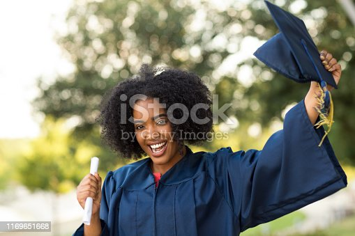 istock Happy African American woman at graduation. 1169651668