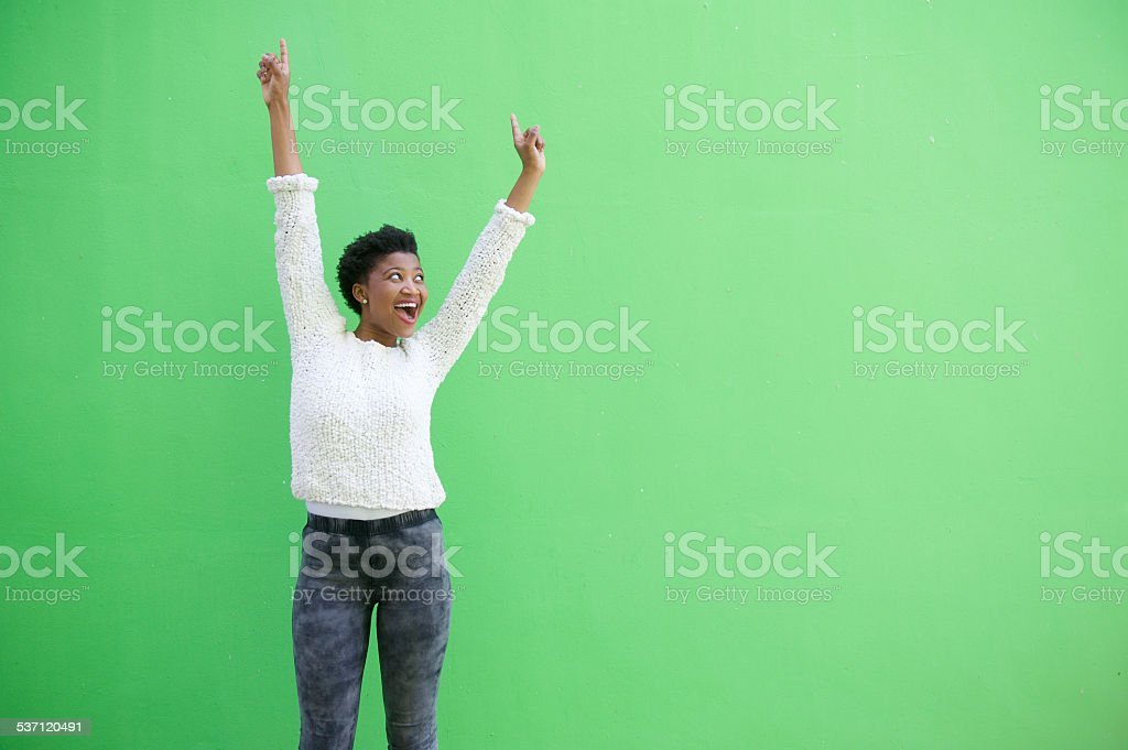 Happy african american woman cheering with arms raised stock photo