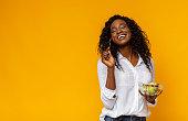 istock Happy african american woman enjoying vegetable salad 1178526666