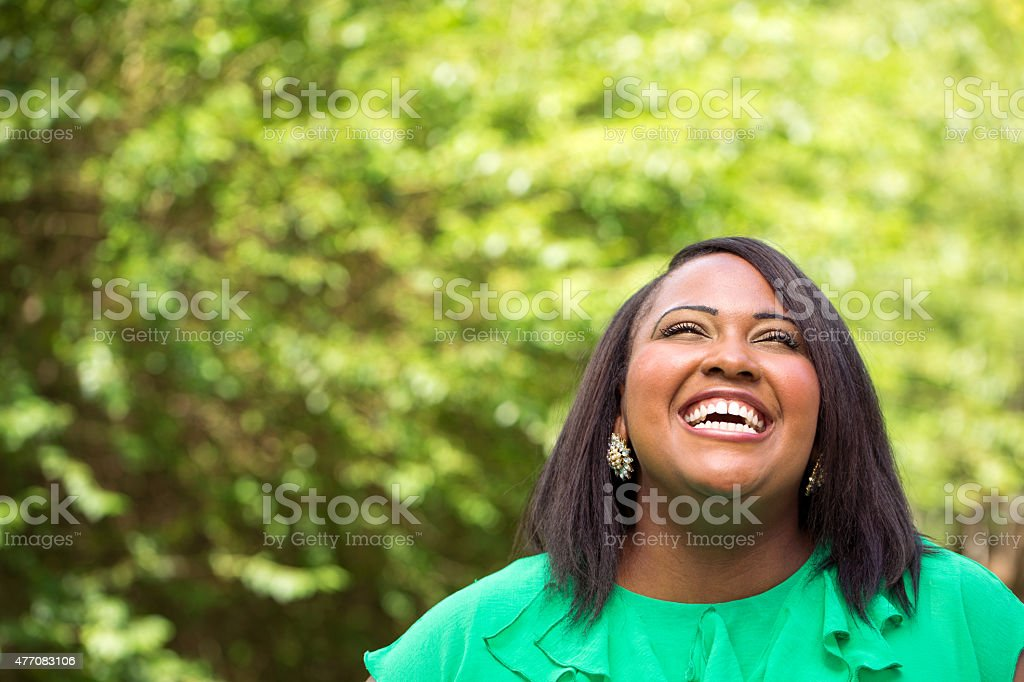 Happy African American woman laughing stock photo