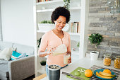 istock Happy African American woman preparing a nutritional breakfast at home 1277415379
