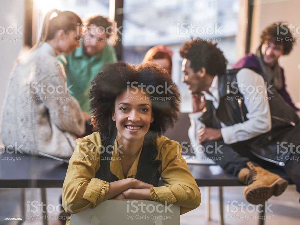 Happy African American woman sitting in the office. royalty-free stock photo