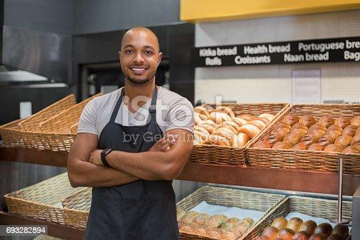 istock Happy african baker man 693282894
