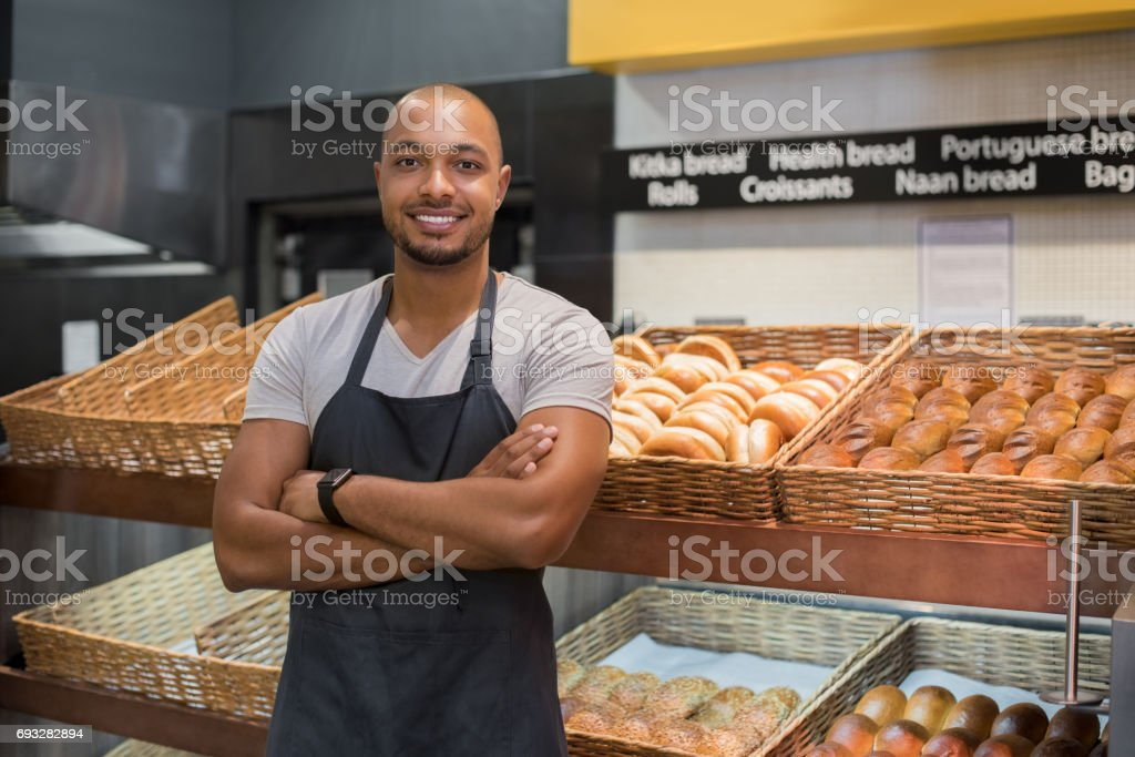 Happy african baker man stock photo