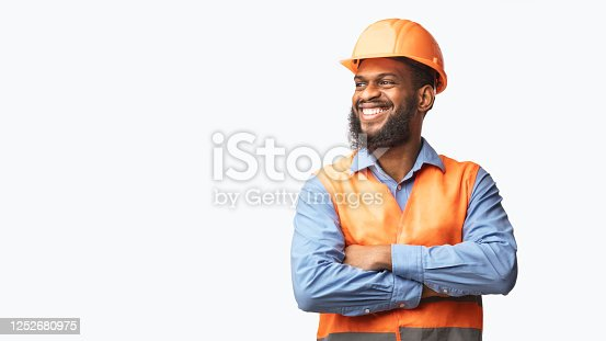 Happy African Builder Workman Standing Pleased Crossing Hands Posing On White Studio Background. Panorama, Copy Space
