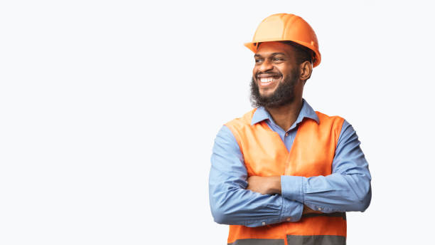 Happy African Builder Standing Pleased Posing On White Studio Background stock photo