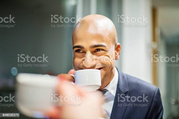 Happy african businessman having coffee picture id646035370?b=1&k=6&m=646035370&s=612x612&h=a98thj2qbvueovt orflfi7nritfuk97wlmq0wcd b0=