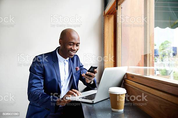 Happy african businessman using phone at cafe picture id508902090?b=1&k=6&m=508902090&s=612x612&h=upykjo4mikrhea2h1q1bgzceikgbldiql6oodjkmvxw=