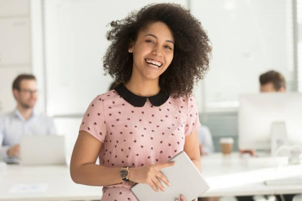 Happy african businesswoman holding digital tablet looking at camera picture id1135346399?b=1&k=6&m=1135346399&s=612x612&w=0&h=t5zuxji j8oc7oaq7wlpct2sito73kzatd6zklx9pis=