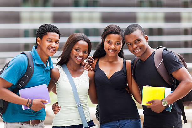 happy african college friends stock photo