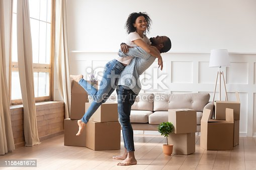 istock Happy african couple first time home buyers celebrate moving day 1158481672