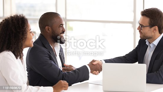 istock Happy african couple shake hand of insurer buy insurance services 1151593870