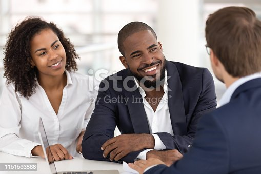963814372istockphoto Happy african family couple listen realtor insurer consulting clients 1151593866