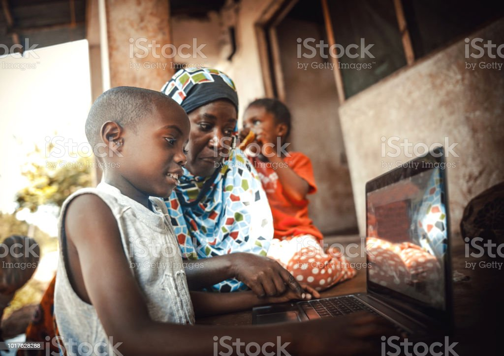 Happy  african family  together using laptop Happy  african family  together using laptop 30-39 Years Stock Photo