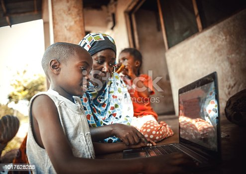 Happy  african family  together using laptop