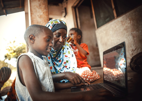 Happy African Family Together Using Laptop Stock Photo - Download Image Now