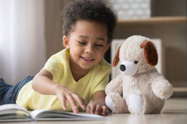 Happy african little boy playing alone reading book to toy picture id1135353595?b=1&k=6&m=1135353595&s=612x612&w=0&h=ysol9qwtm suc2e htmydrvlczbnlypsa7atk6thlwc=