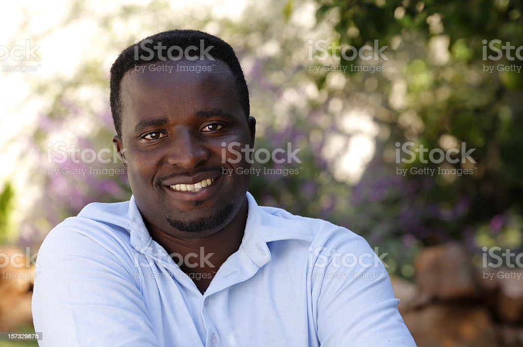 Happy African man relaxing royalty-free stock photo