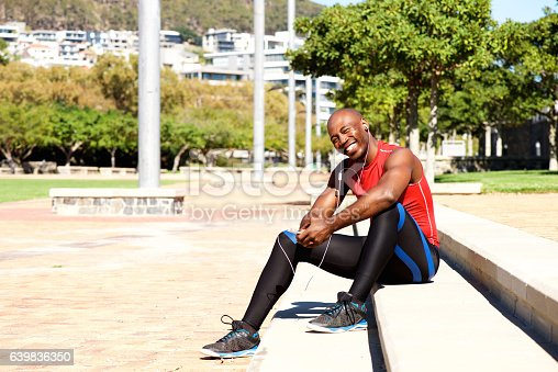 istock Happy african man taking break from physical training 639836350