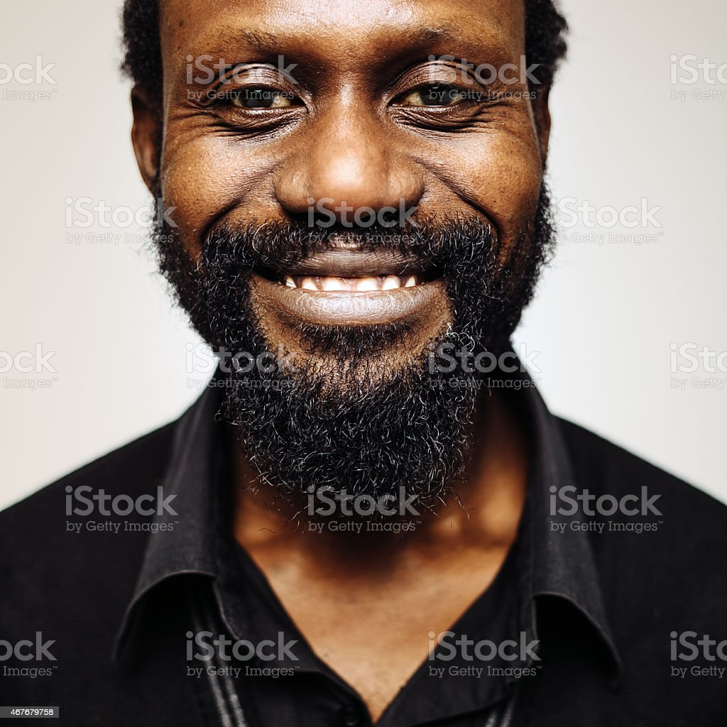 Happy african mid age man portrait with beard smiling. stock photo